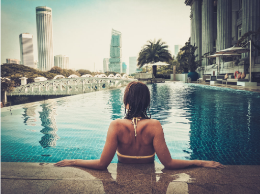 picture of a woman with her back facing the camera while sitting in a swimming pool
