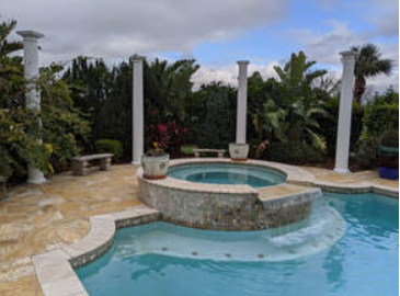 Picture of a pool with three columns in the background